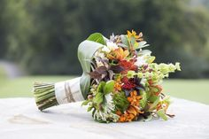 Fall wedding with orange and green. Photo by Julie, Jewels Photography, Flowers by Tami McAllister