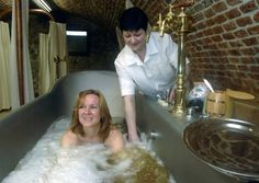 Beer Bath. Jana Tymlova enjoys a soak in the Real Beer Baths launched by the family brewery Chodovar in Chodova Plana, Czech Republic. The bath consists of water and mineral water IL-SANO, but the major bath ingredient is dark beer which is produced in a traditional way based on the copyright original method and made by the main brewer of the family brewery only.