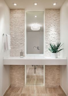 LED LIGHTING Also features these 2014 trends: little ornamentaion, quartz solid color countertop, stone mosaic backsplash wall tile.