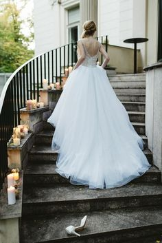 Cinderella inspired wedding with candles lined up the staircase.