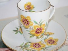 Slim high teacup and saucers with yellow wild roses Mosa Maastricht