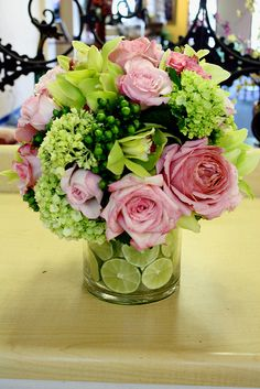 flower arrangement with limes...but instead of pink roses i will take white or blue hydrangeas