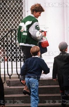 January 10, 1991: Princess Diana with Prince William and a friend leaving Prince Harry on the first day of his school term after the Christmas and New Year holidays at Wetherby Preparatory.