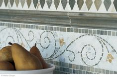 Traditional Italian mosaic - Above Image: Opus Anticato Calacata / Verde Luna Harlequin Field, Verde Luna Rail Molding, Rimini Border, Verde Luna Old World Field   Luxury awaits in a room steeped in the Old World beauty and tradition of Opus Anticato. This generous selection of colorful Italian mosaic borders, patterns and moldings is a timeless expression of mosaic design, making available some of the world's most sought after marbles such as Giallo Antico, Murgiano and Calacata, to name a ...
