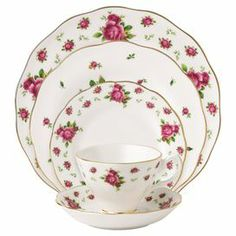 """Crafted from fine bone china and featuring a charming rose motif, this elegant dinnerware set is the perfect finishing touch to your dinner party tablescape.  Product: Dinner plate Salad plate Bread and butter plate TeacupSaucerConstruction Material: Bone chinaColor: PinkFeatures: Roses along the trimDimensions: 11.2"""" Diameter (dinner plate)"""