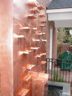 dad.  he'd like this for the copper.  Like the copper wall in his house....Custom Made Copper Waterfall by Dumay Gorham Designs, LLC.