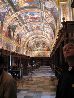 El Escorial Library at El Escorial in Spain. The library, designed by Juan de Herrera, is located in a great hall 180 feet long by 30 feet wide by 32 feet tall, with marble floors and beautifully carved wood shelves. The frescoes on the vaulted ceilings were painted by Pellegrino Tibaldi, and depict the seven liberal arts: Rhetoric, Dialectic, Music, Grammar, Arithmetic, Geometry and Astronomy.