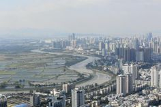 The Shenzhen River separates the high-rises of Shenzhen, China, from farmland in Hong Kong. China has come under criticism for the amount of...