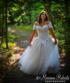 Bridal Portrait of a Bride Dancing in the Forest at Beaver Lake Nature Center by Mariana Roberts Photography, via Flickr