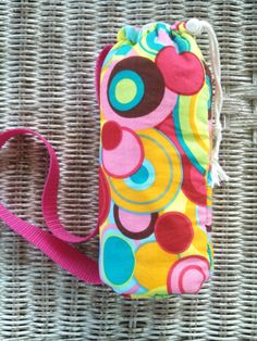 Colorful and Pretty water bottle carrier I made that's insulated and has a terry towel lining to absorb the moisture.