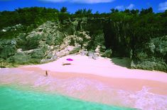 This is the Pink Sands Beach located off of Harbour Islands near the Bahamas. The pink sand comes from tiny particles from the surrounding reef!