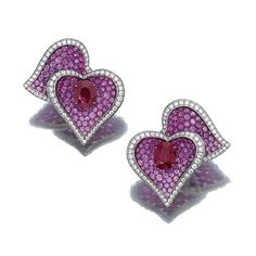 PAIR OF RUBY, PINK SAPPHIRE AND DIAMOND EAR CLIPS, 'PASSION', TARDITI. Each designed as pair of hearts, the oval ruby, to a ground pavé-set with circular-cut pink sapphires, edged with brilliant-cut diamonds, mounted in titanium, maker's marks, case.
