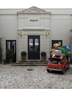 10 Best Paris Design Stores and Galleries - Architectural Digest Merci Store Paris, Merci Boutique, Boutique Ideas, Pop Up, Metal Bistro Chairs, Souvenir Store, Grand Paris, Sloped Garden, Paris Shopping