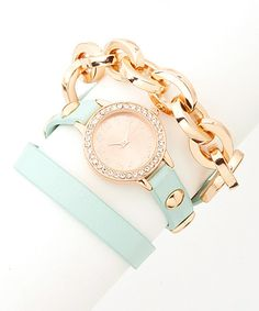 Slip this sleek arm candy over wrists for a wow-worthy pop of pretty. Boasting gleaming accents, this wrap watch looks lovely worn alone or stacked with other bracelets for layer upon layer of chunky, trend-savvy style.Case: 1.25'' W x 0.25'' DBracelet:0.75'' W x 22'' LAlloy / glassA...