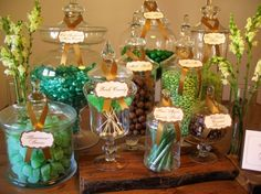 """This candy buffet was designed around the colors green and brown with a the theme of an """"enchanted forest"""". We used some props for enhancement. We used wooden slabs as risers, which gav… Buffet Dessert, Lolly Buffet, Candy Buffet, Candy Table, Dessert Tables, Enchanted Forest Prom, Enchanted Forest Decorations, Enchanted Garden, Lolly Jars"""