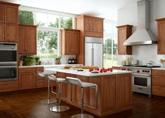 light cherry cabinets with white island   North Andover Door Style in Cherry with Light stain