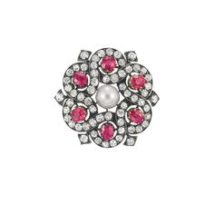 Antique Pearl, Ruby and Diamond Brooch  Silver, gold, the stylized pinwheel motif centering one taupe pearl approximately 6.6 mm., encircled by 6 cushion-shaped rubies approximately 1.65 cts., set with 60 old-mine cut diamonds approximately 1.85 cts., approximately 5.4 dwt.  Victorian or Victorian style.