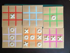 DIY noughts and crosses games for party bags. Made with M10 plastic washers, 5mm tile spacers, manilla wages envelopes and left over paper from cup and ball games.