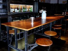 vintage industrial cafeteria table. Love the swivel seats. No moving chairs to mop! But finish is too dark.