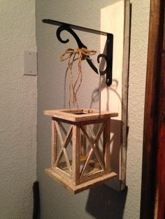 A piece of wood and a shelf hanger makes a perfect lantern hanger.
