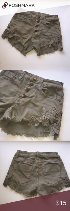 Mossimo Olive Green High Waister Denim Jean Shorts Beautiful Mossimo Olive Green High waisted Denim jean shorts in excellent preowned condition! Gently worn. Lovely lace detail on the sides and 4 buttons in the front! Mossimo Supply Co. Shorts Jean Shorts