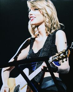I love when Tay plays the guitar. Just a girl and her guitar. <3