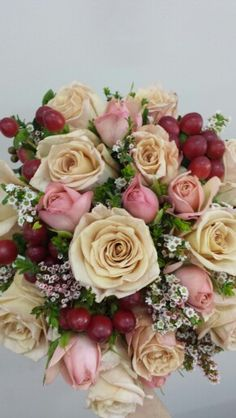 Honeymoon roses spray roses and hypericum berries with accent of thrip