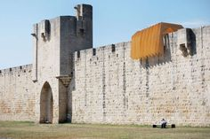 Haven by NAS Architecture, Aigues-Mortes, France  This structural installation on the medieval city walls of a town in France presents a material contrast to the historic gates it rests on in an effort to create a modern identity for the community. Highly visible from below, this series of plywood attachments are meant to impart an intimate experience when passed through from within, as one traverses the ramparts.