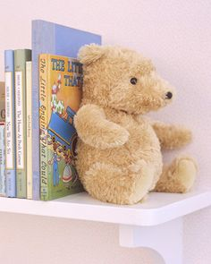What's an old bear to do when your baby only has eyes for his stuffed giraffe? He can become a handsome bookend. Use a seam ripper to open the fabric at the animal's seat. Stuff his bottom with rocks, then resew the seam carefully so no rocks can spill out. At night, when no one is looking, he can catch up on his reading.