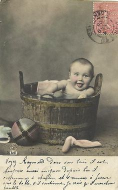Baby in the washtub....absolutely adorable! Marguerite's comment: So was this the beginning of all the baby in flower pot, baby in basket, baby in suit cases? http://babyphotographyclasses.com/