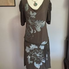 NY&CO DRESS- XS Super comfortable & stretchy! Nice taupe  color with blue floral design. Dropped waist with elasticized back & front tie belt. Excellent condition! Length 33 New York & Company Dresses