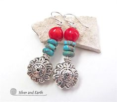 Colorful and full of charm, these handmade earrings feature silver flower beads accented with red coral and natural turquoise. The flowers have a gorgeous sculptural, detailed design and are sterling silver plated. The turquoise is a pretty shade of blue, with some natural inclusions, while the red coral adds a vibrant pop of color. They are wrapped in solid sterling silver wire and dangle from sterling silver ear wires.   These earrings are lightweight  fun to wear. Theyll make a great gift…