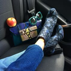 Brocade booties and a snakeskin clutch.