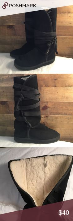 Women's EMU tall shearling wrap boots - Size 7 Barely worn, black shearling ribbon wrap boots. Runs a little big. Size down for perfect fit. Emu Shoes Winter & Rain Boots