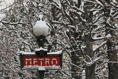 Paris snow: Snow covers a Metro sign and tree branches
