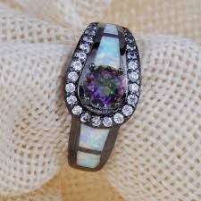 Resultado de imagen para anillos de oro para mujer con piedras grandes