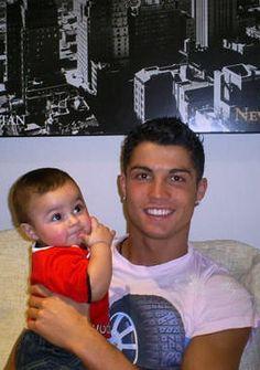 Cute baby with his cute daddy! <3 Cristiano Ronaldo