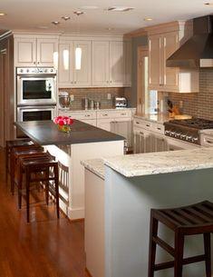 painted hood, slate countertop, granite bianco romano. River Oaks White Kitchen by Ashley Scherch - modern - kitchen - houston - Cabinets & Designs