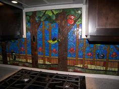 LOVE this mosaic backsplash.