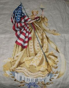 Lady of the Flag from Mirabilia. This was designed as a 9/11 memorial and I loved stitching it, although the yellow/tan got me after a while. Not sure if it was the intention, but to me the three roses she's holding represent the three places hit on 9/11. I love the shading in the flag.