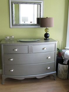 An old Duncan Phyfe dresser given to us by one of Jim's customers.  Painted with Ralph Lauren silver and replaced hardware.  2009