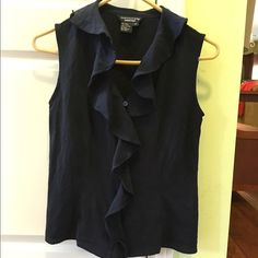 Doncaster navy silk ruffle tank top In like new condition with no rips or stains. Beautiful silk button down tank with a ruffle down the middle. Length is 20 inches and armpit to armpit measures 16 inches across. Thanks for looking. Doncaster Tops Tank Tops