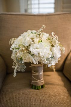 white hydrangea wedding bouquet with burlap wrap.