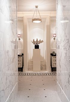 Incredible entry hall , filled with marble from top to bottom to his and her bathroom and closets. Delightfully talented POWELL & BONNELL