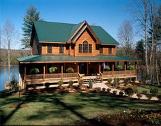 windows for log cabin house with wrap around porch | log cabins are awesome. wrap-around porch is a must.