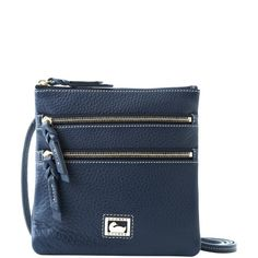 Dooney & Bourke North/South Triple Zip. comes in 6 colors.