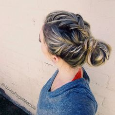 Three loose french fishtail braids in a messy bun