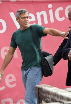 George Clooney Photos - George Clooney leaves the Cipriani hotel and heads for the airport after attending the International Venice Film Festival. George Clooney, Amal Clooney, Mature Mens Fashion, Face Expressions, Hollywood Actor, Movie Stars, Shirt Style, Beautiful Men, Gentleman