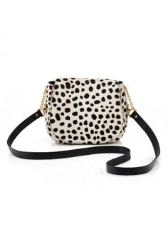 Young+British+Designers:+Mini+Bag+in+Cheetah+Spot+Hair+on+Hide+by+Baia+Bags+-+Oh+how+we+all+love+a+bolt+of+animal+print,+particularly+of+the+big+cat+variety.+This+perfectly+formed+mini+bag+is+just+big+enough+to+fit+all+of+your+essentials+in+and+then+fish+them+out+often+just+so+you+can+revel+in+the+soft+pink+suede+interior.