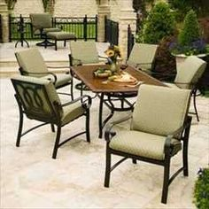 """Wilshire Cushioned Dining Groups - 90"""" Rectangular Dining Table with 8 Swivel Rockers - Aluminum Patio Furniture by Woodard. $5699.00. Aluminum Patio Cushioned Dining Groups - 90"""" Rectangular Dining Table with 8 Swivel Rockers. Visit our site for Cushion Color and Aluminum Finish options. Elegant and traditional, the Wilshire Cushion collection offers the best in large scale pieces highlighted with generous comfortable cushions. With a look of solid, bar stock ..."""
